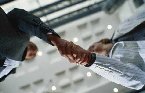 business-handshake-meeting-deal-low-angular-700x45_660